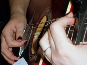 Fingers on the fretboard